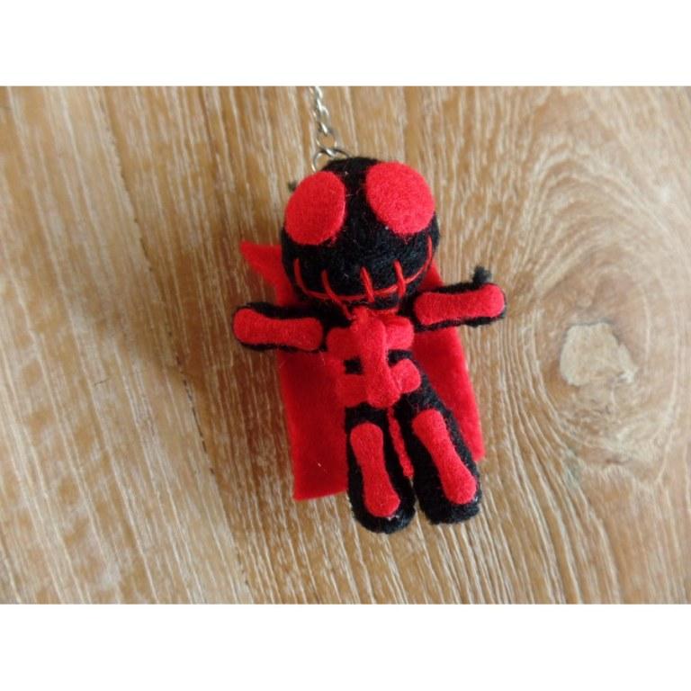 Porte clé skeletor noir/rouge