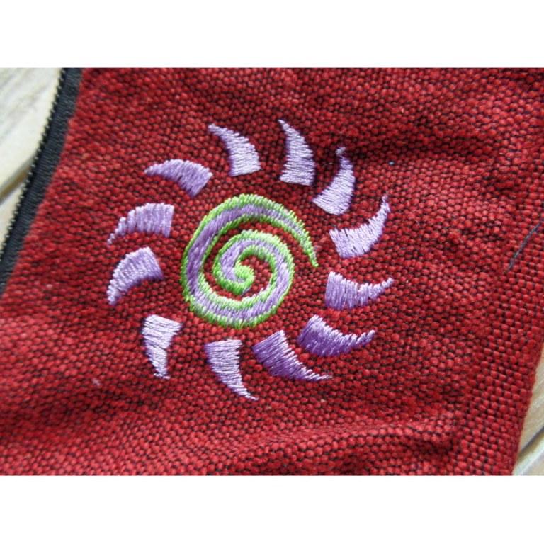 Porte monnaie bordeaux spirale soleil parme