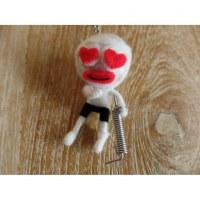 Porte clés la fille à la béquille blanche