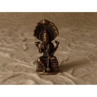 Miniature Bouddha sous abri serpent