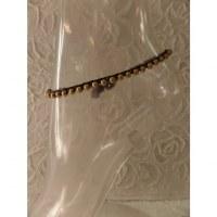 Bracelet de cheville 1 rang perles dorées
