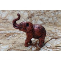 Petit éléphant rouge cuivré